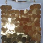 γιλέκα με νομίσματα από χρυσό