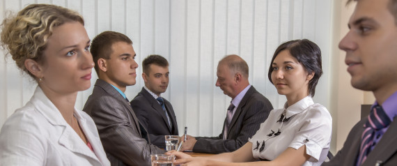 A group of business people are passing interview at the office