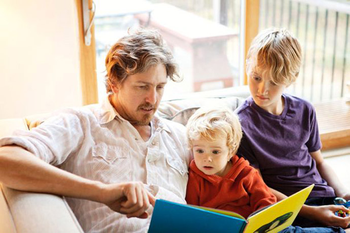 Father-reading-a-book-to-his-sons