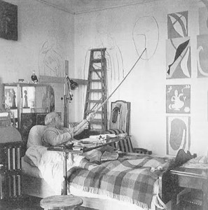 matisse in bed drawing with long stick