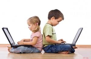 Little girl and boy using laptops