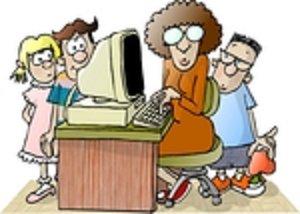 teacher_sitting_at_a_computer.jpg